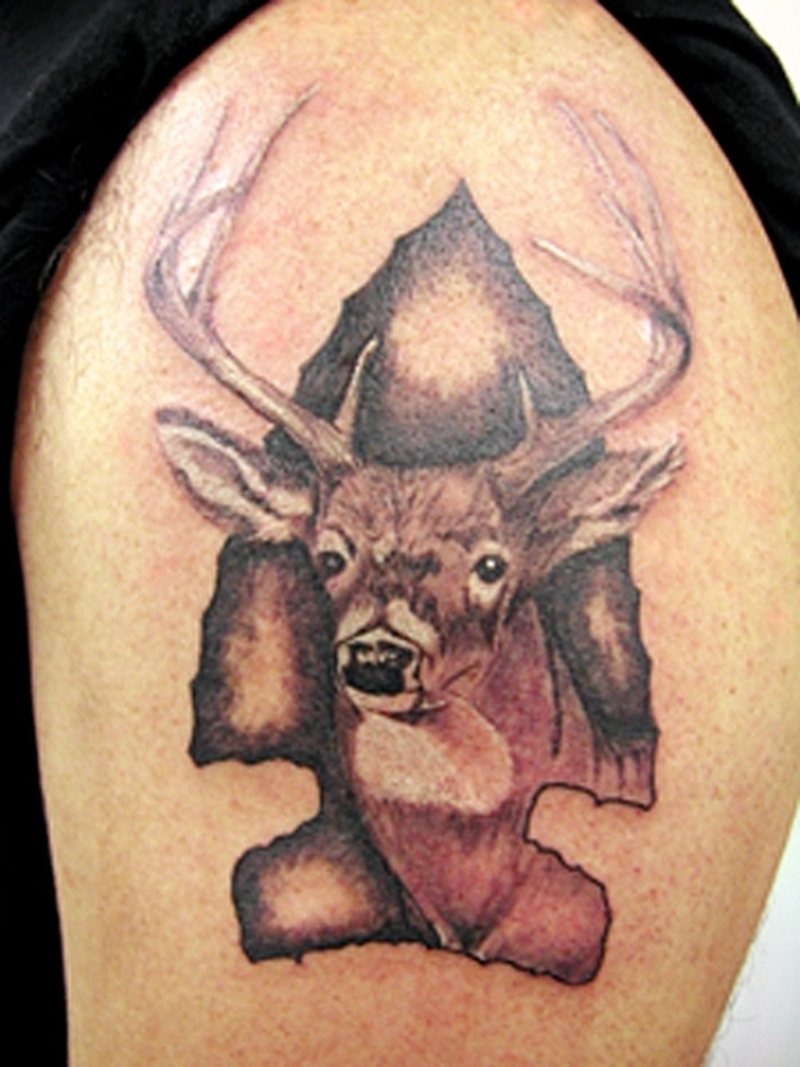 Brown deer tattoo on upper arm