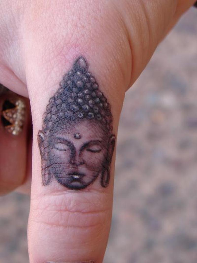 Buddha finger tattoo