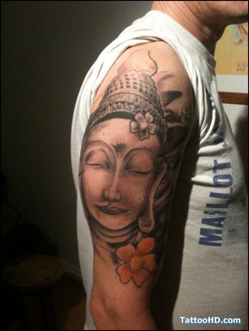 Buddha head flower tattoo on shoulder