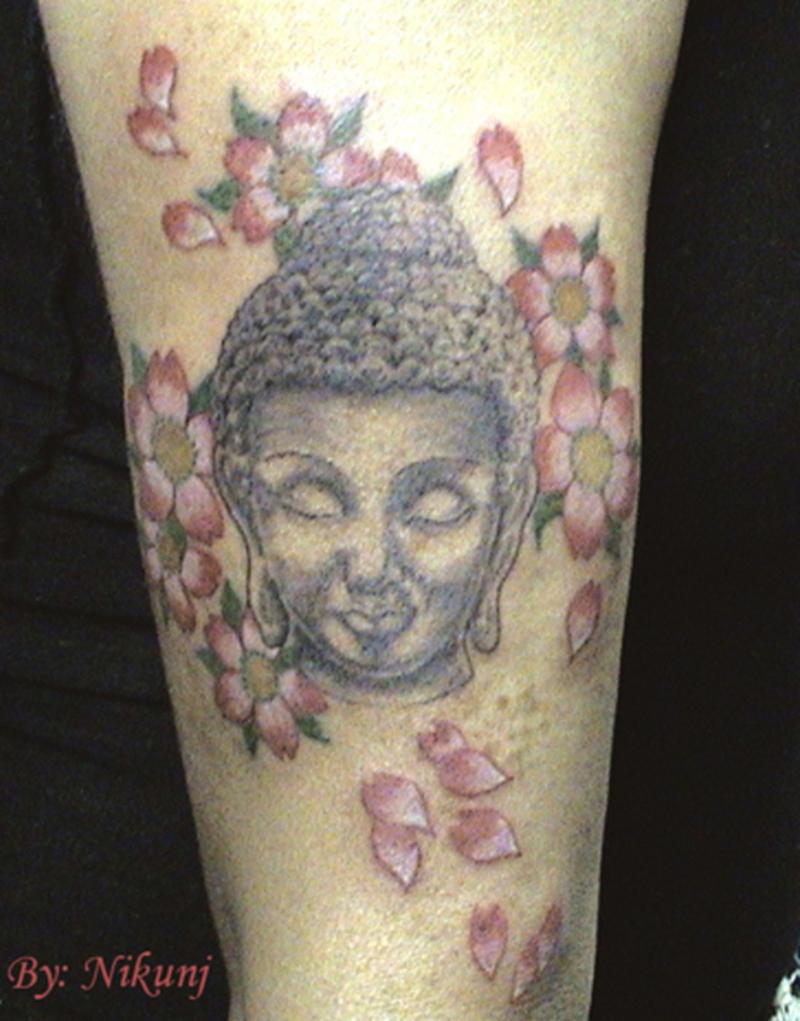 Buddha head flowers tattoo