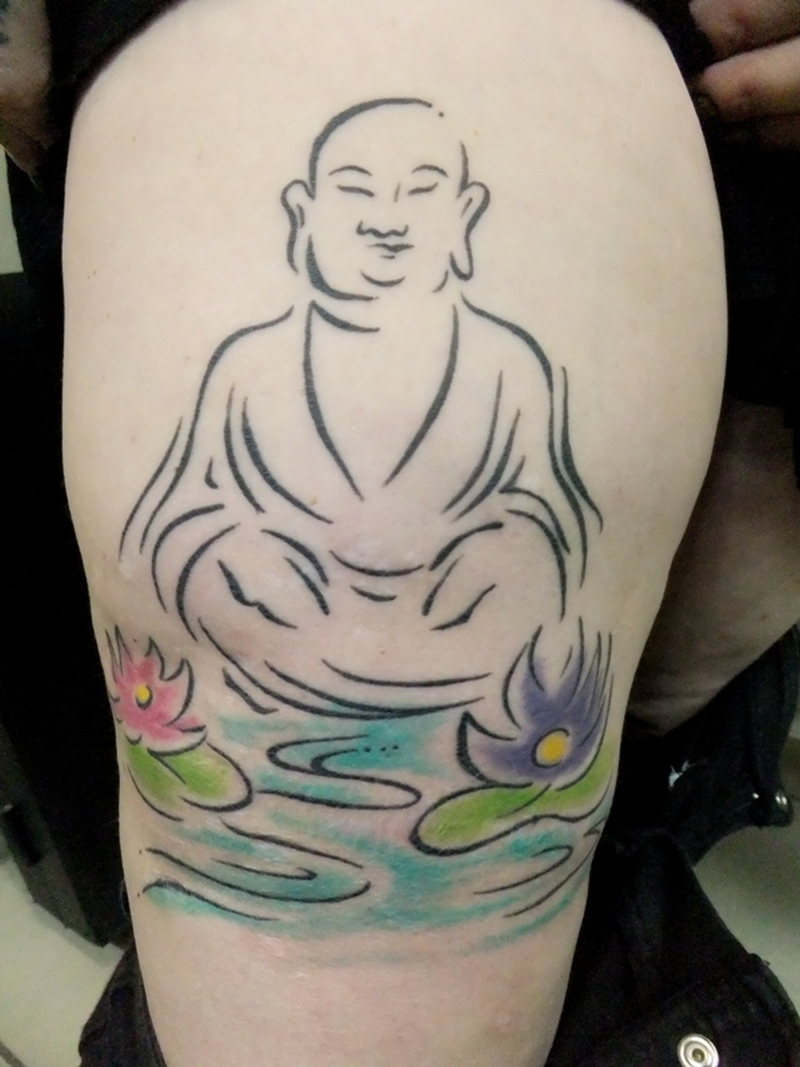 Buddha silhouette lotus tattoo on upper arm