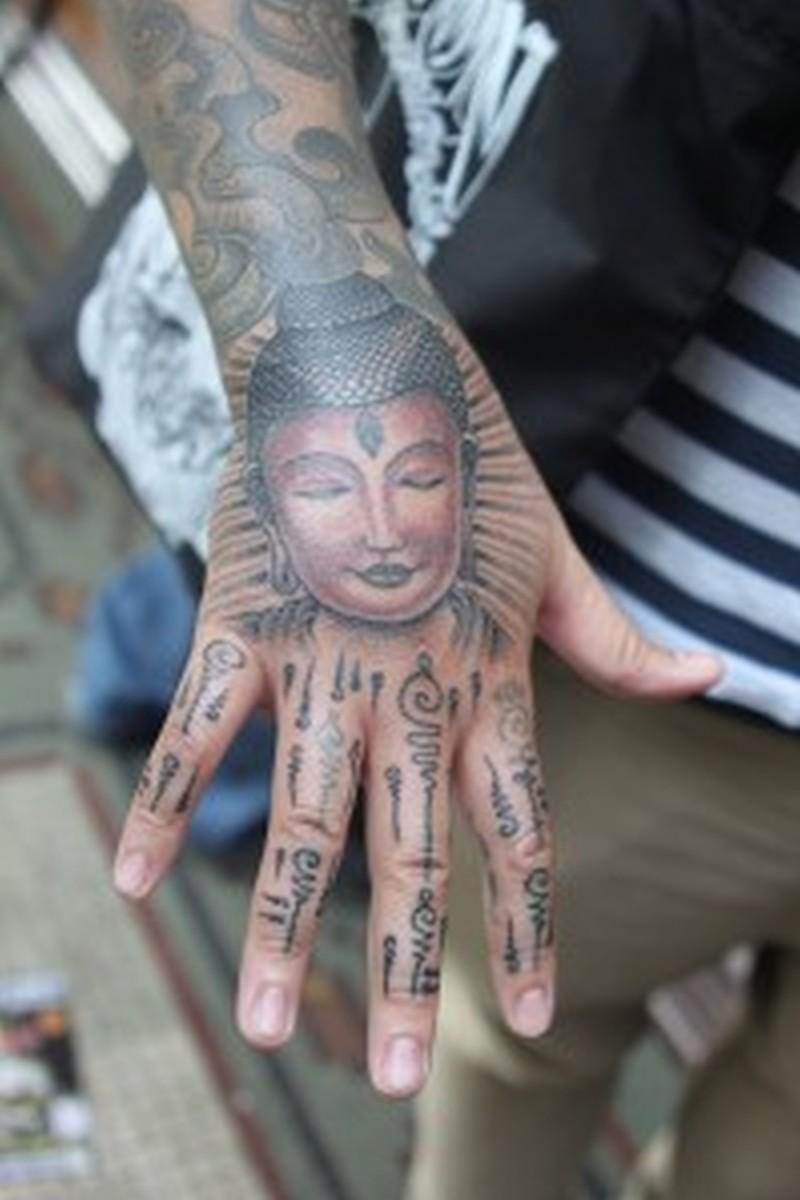 Buddha tattoo design on wrist