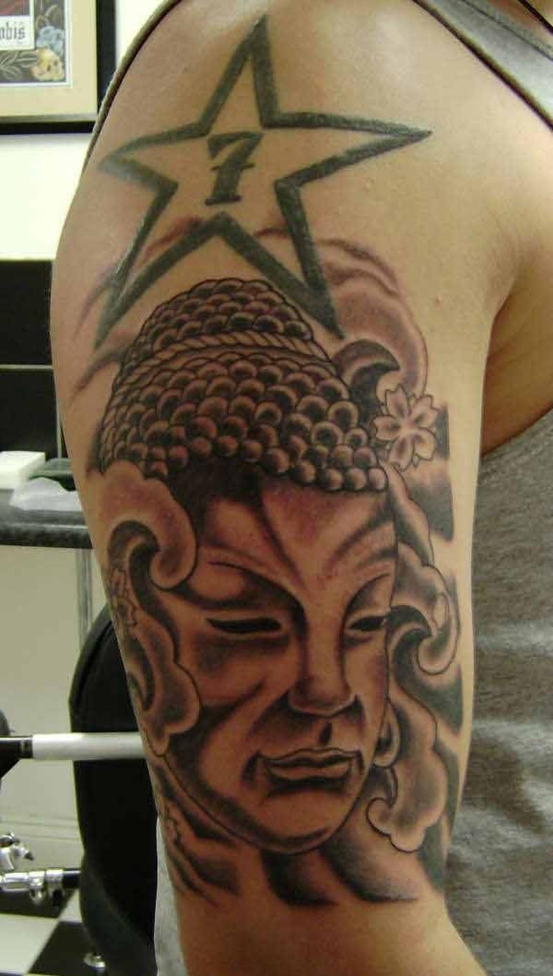 Buddhist Face With Buddhist Symbols Tattoo On Arm Tattoos Book