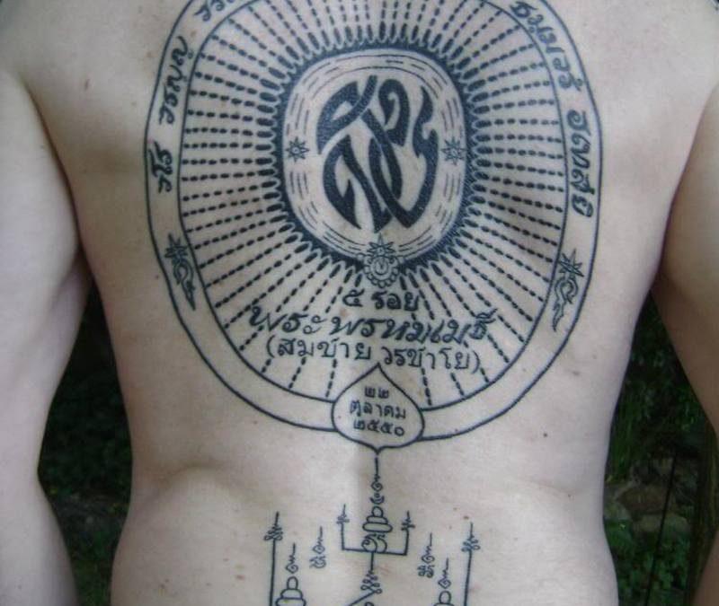 Buddhist tattoo on back body