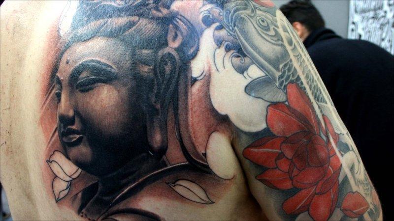 Buddhist tattoo with koi fish red flower