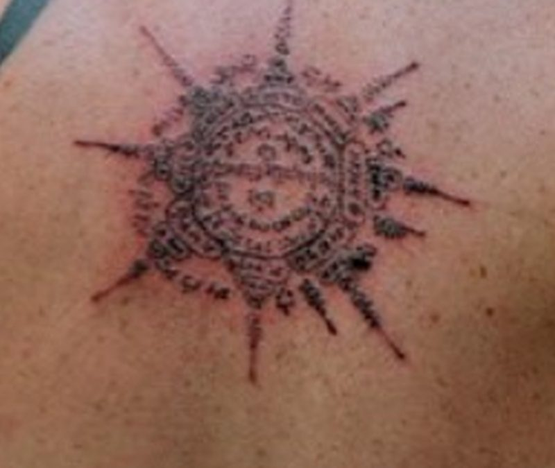 Buddhist wheel tattoo design