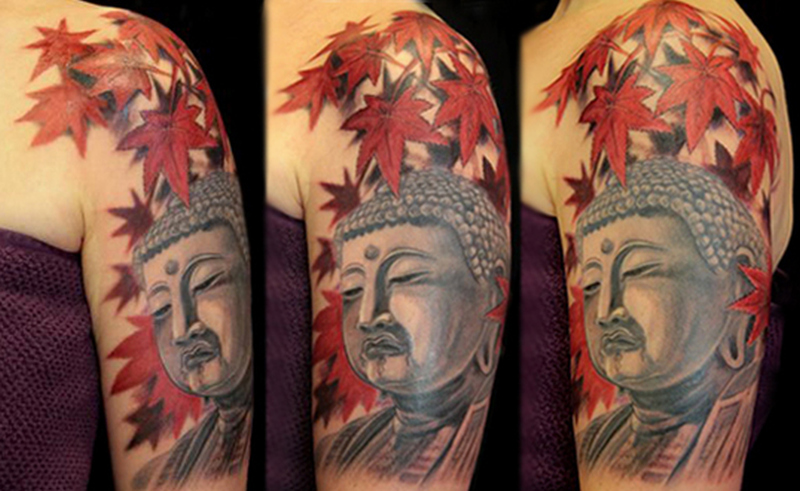 Buddhist with leaves tattoo