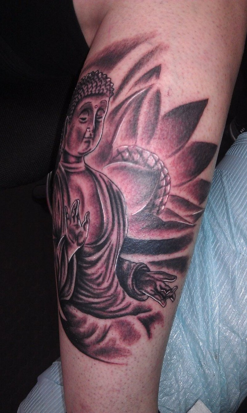 Buddhist with lotus tattoo on elbow
