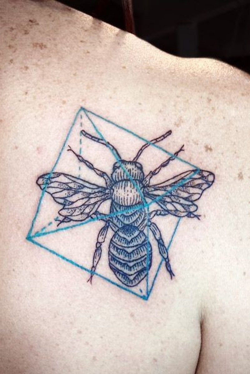 Bug and geometric symbols tattoo on shoulder blade