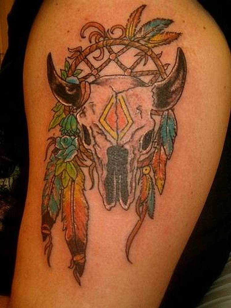 Bull skull and feathers tattoo