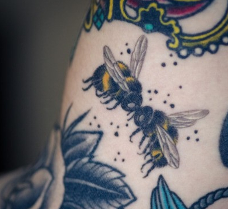 Bumblebee kissing tattoo