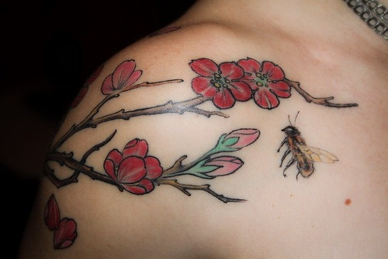 Bumblebee on flowers tattoo