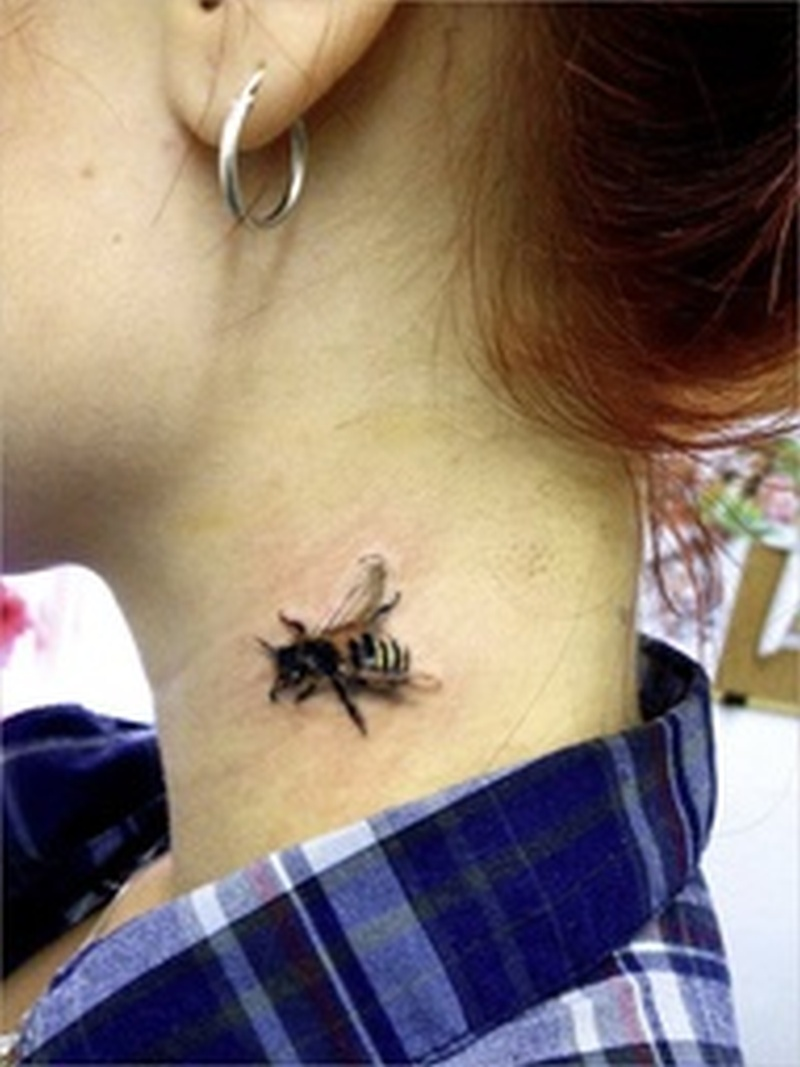 Bumblebee on neck for girls tattoo