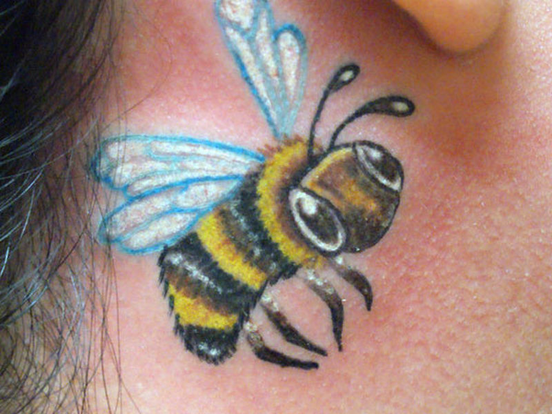 Bumblebee tattoo behind ear