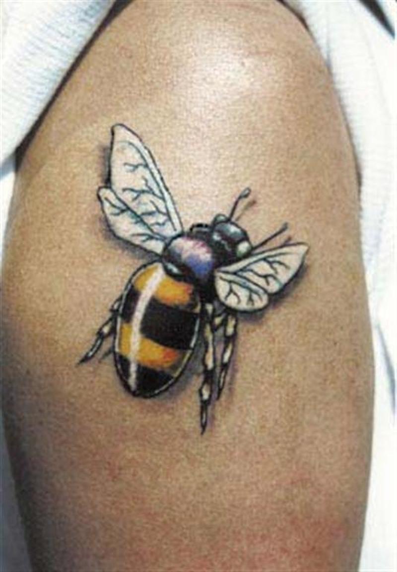 Bumblebee tattoo on biceps