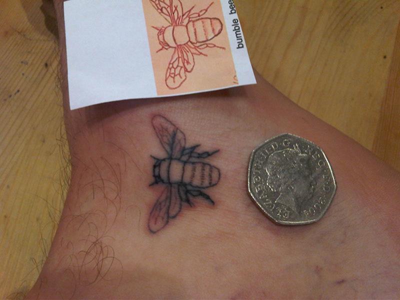 Bumblebee tattoo on foot 2