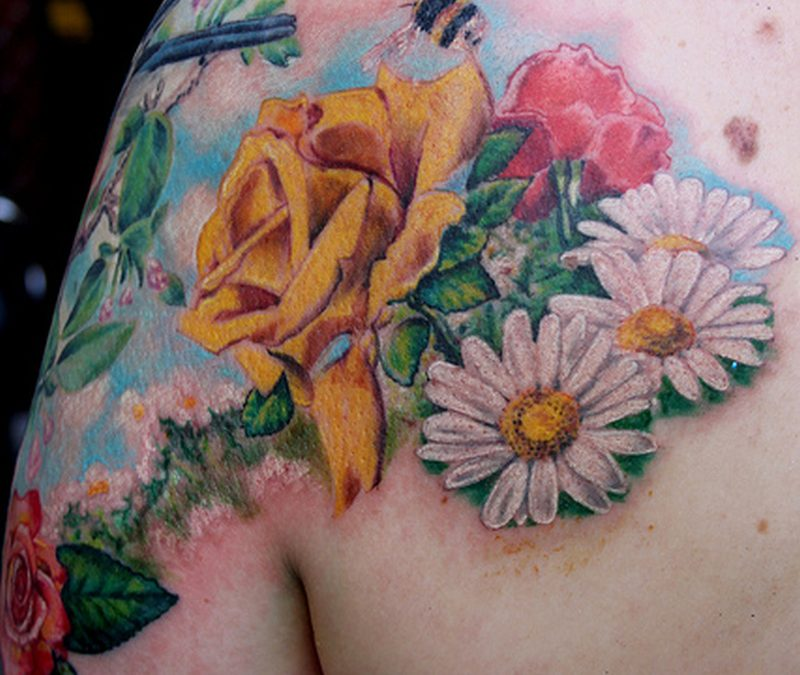Bumblebee tattoo with flowers on shoulder back