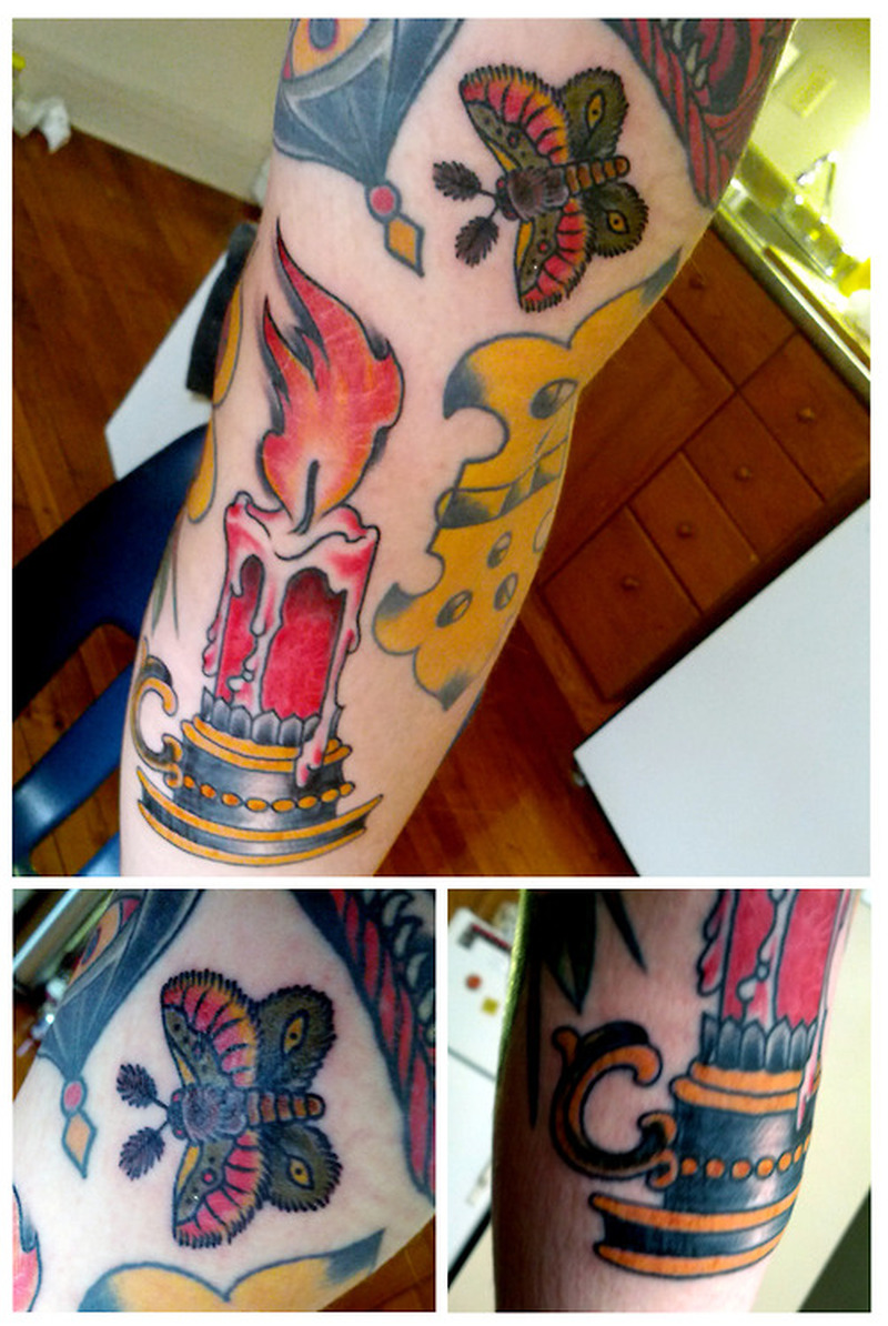 Burning candle with butterfly tattoo design