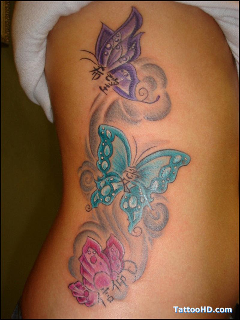 Butterflies tattoo on rib side 2