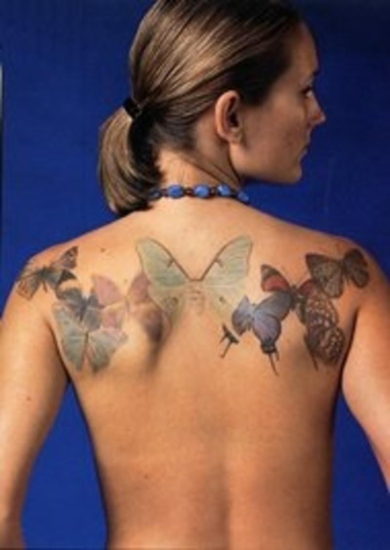 Butterflies tattoo on upper back for girls