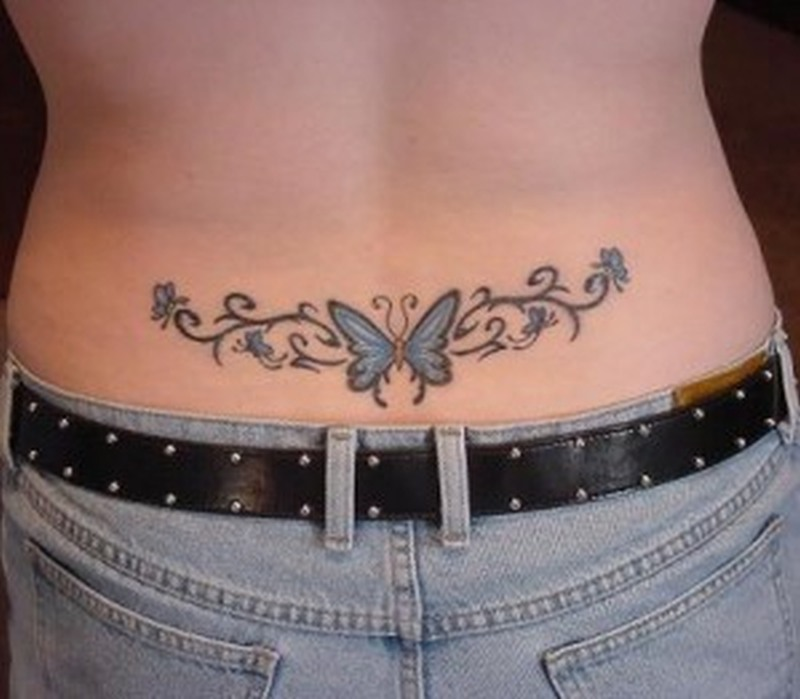 Butterfly colourful tattoo on lower back