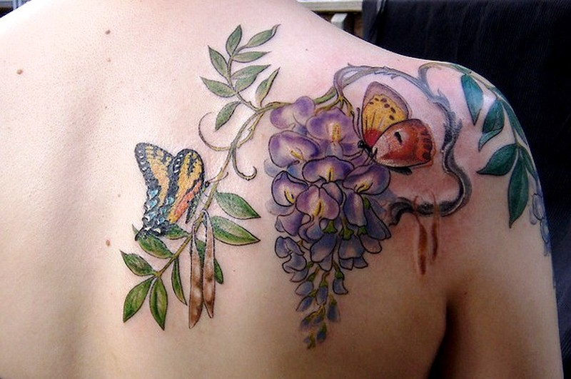 Butterfly floral tattoo on back