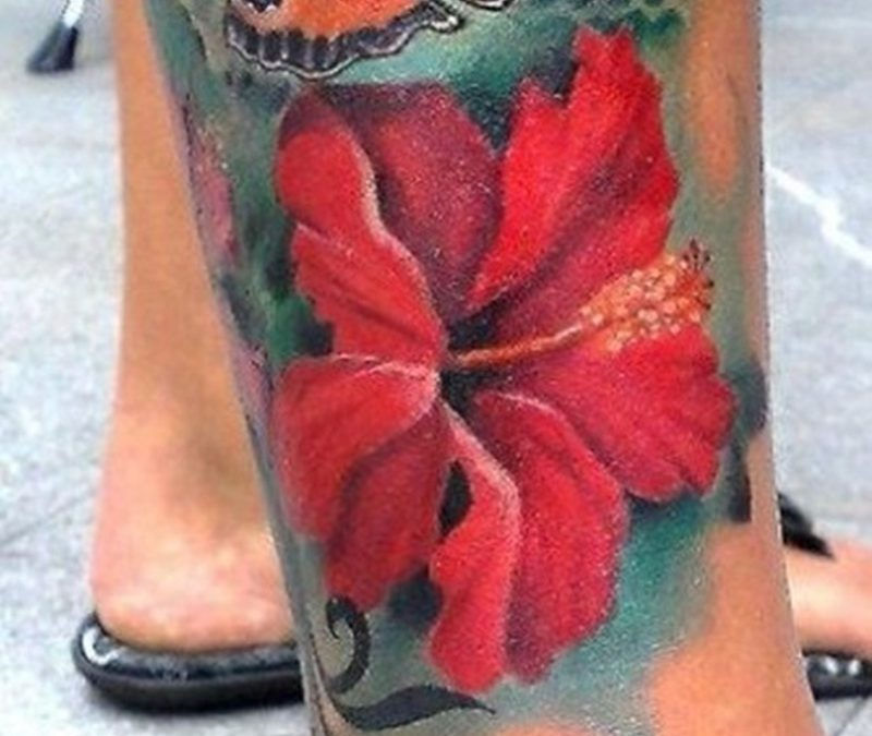 Butterfly hibiscus flower tattoo design for men on calf