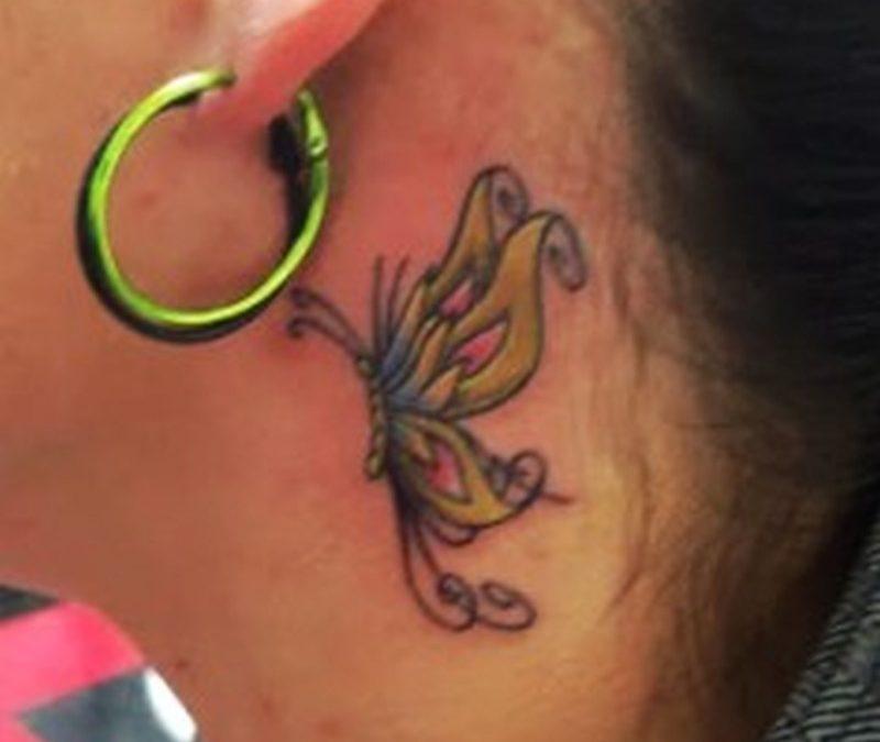 Butterfly tattoo below ear 3
