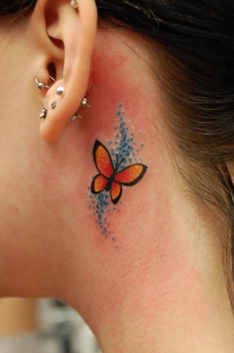 Butterfly tattoo below ear