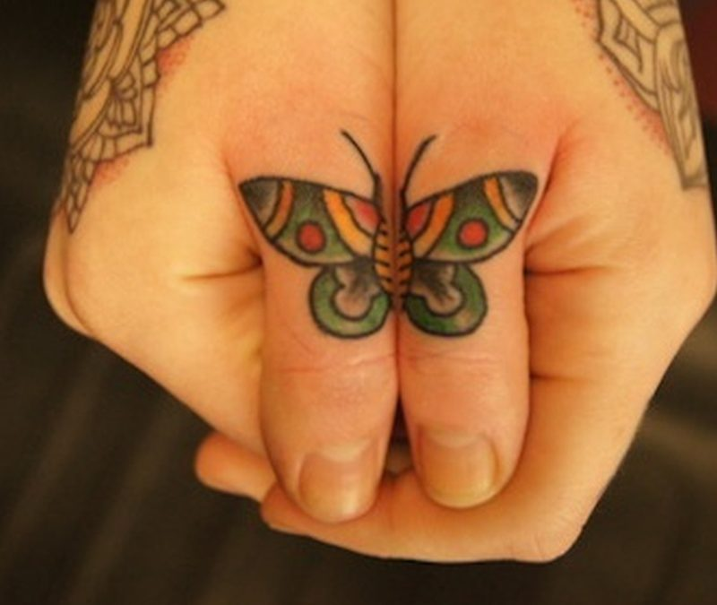 Butterfly tattoo on finger for girls