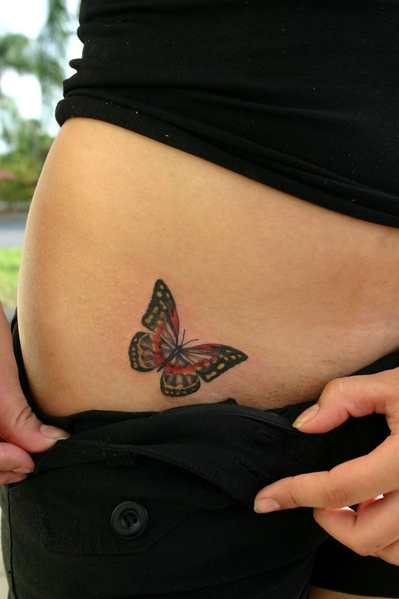 Butterfly tattoo on hip 2