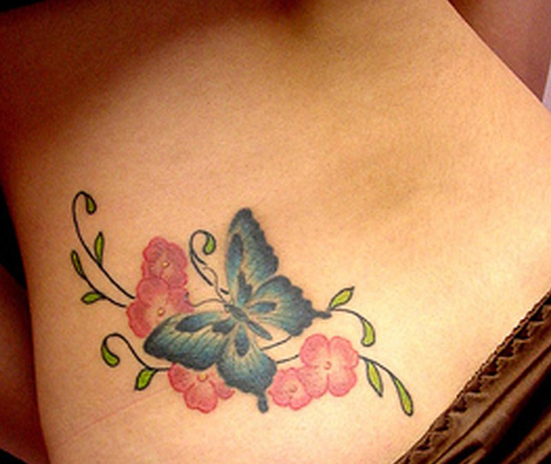 Butterfly tattoo on lower back 2