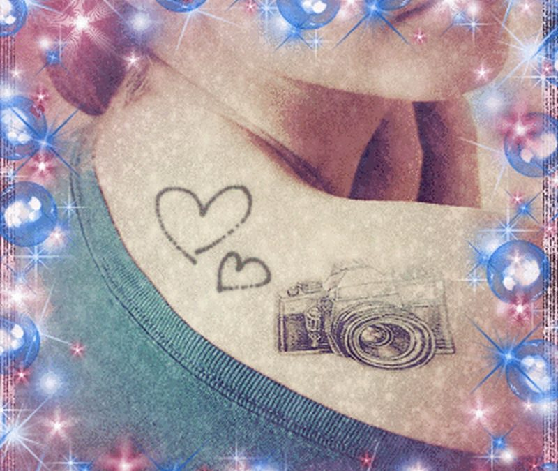 Camera hearts tattoo on shoulder back