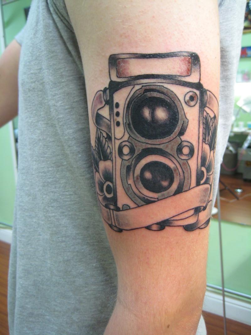 Camera tattoo on biceps 3