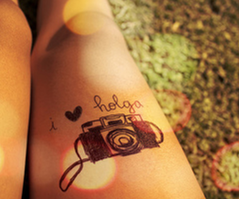 Camera with heart tattoo design