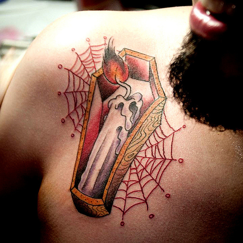 Candle coffin tattoo design on chest