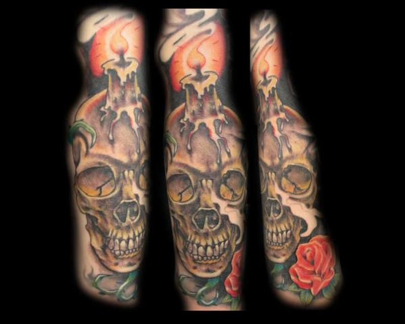 Candle with skull tattoo design