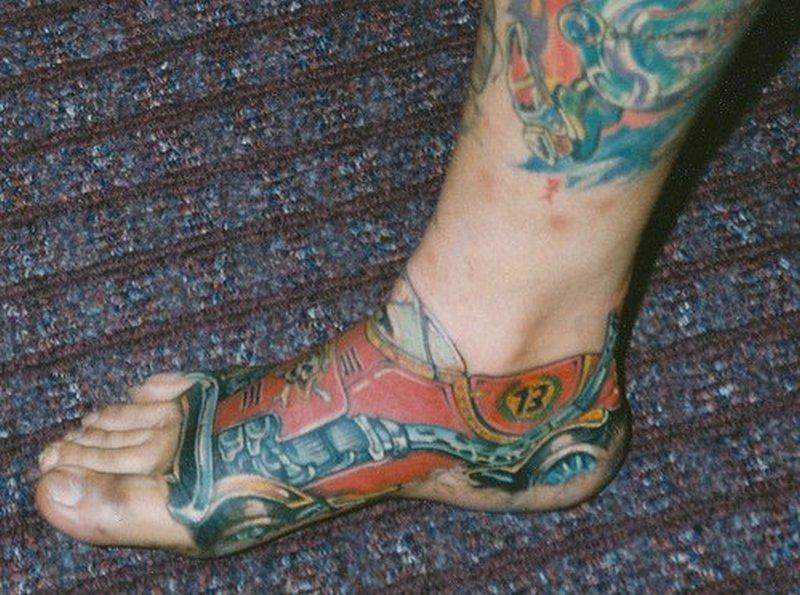 Car tattoo design on foot