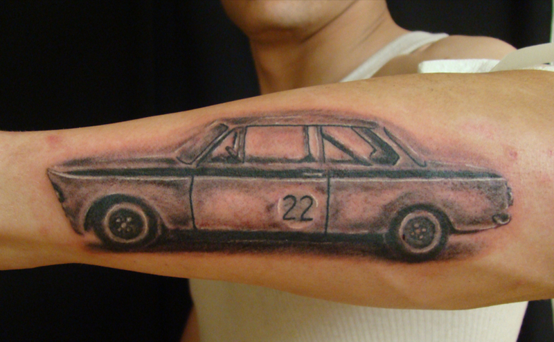 Car tattoo on forearm