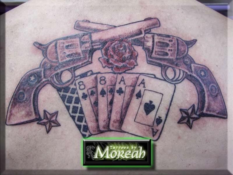 Cards n gun tattoo on back