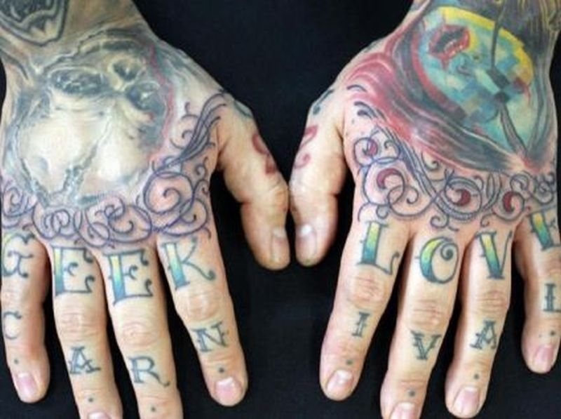 Carnival text tattoo on fingers