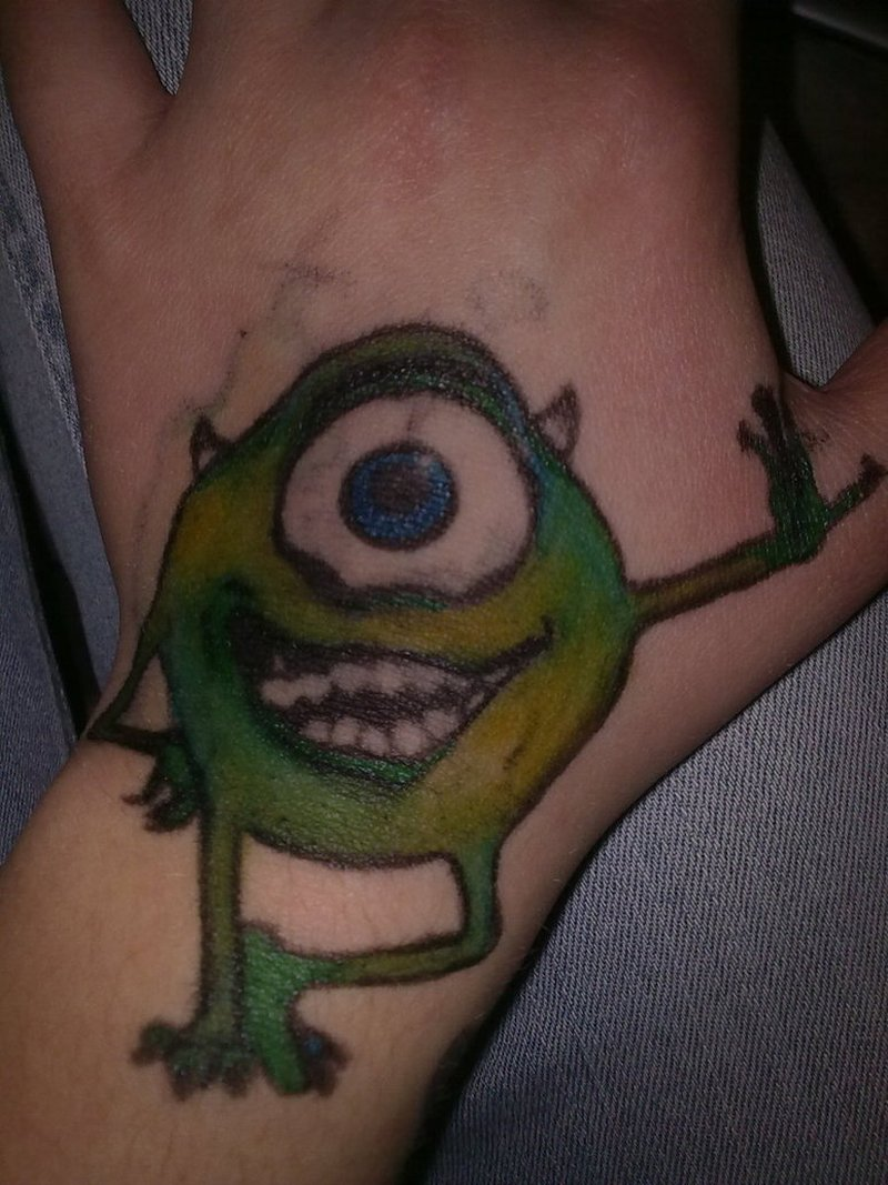 Cartoon alien hand tattoo