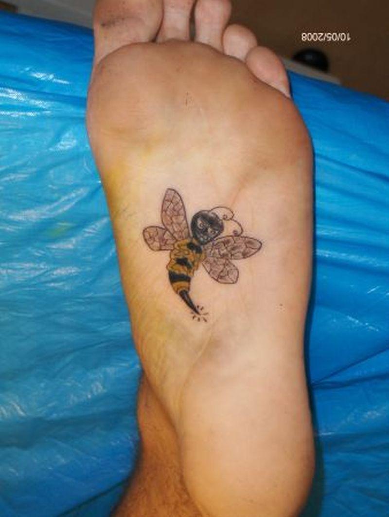 Cartoon bee tattoo on under foot
