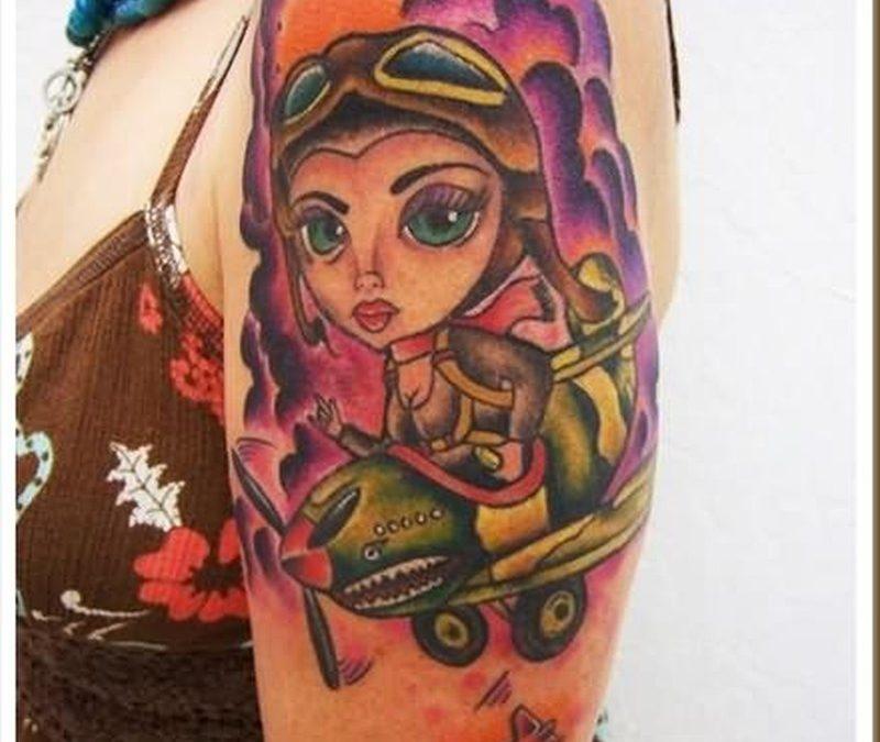 Cartoon girl tattoo on shoulder