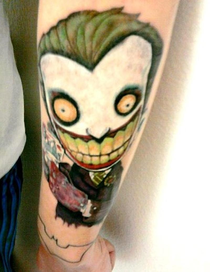 Cartoon joker tattoo on forearm tattoos book for The joker tattoo