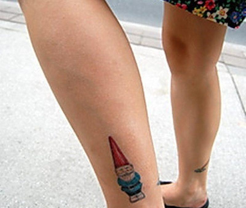 Cartoon tattoo design on ankle