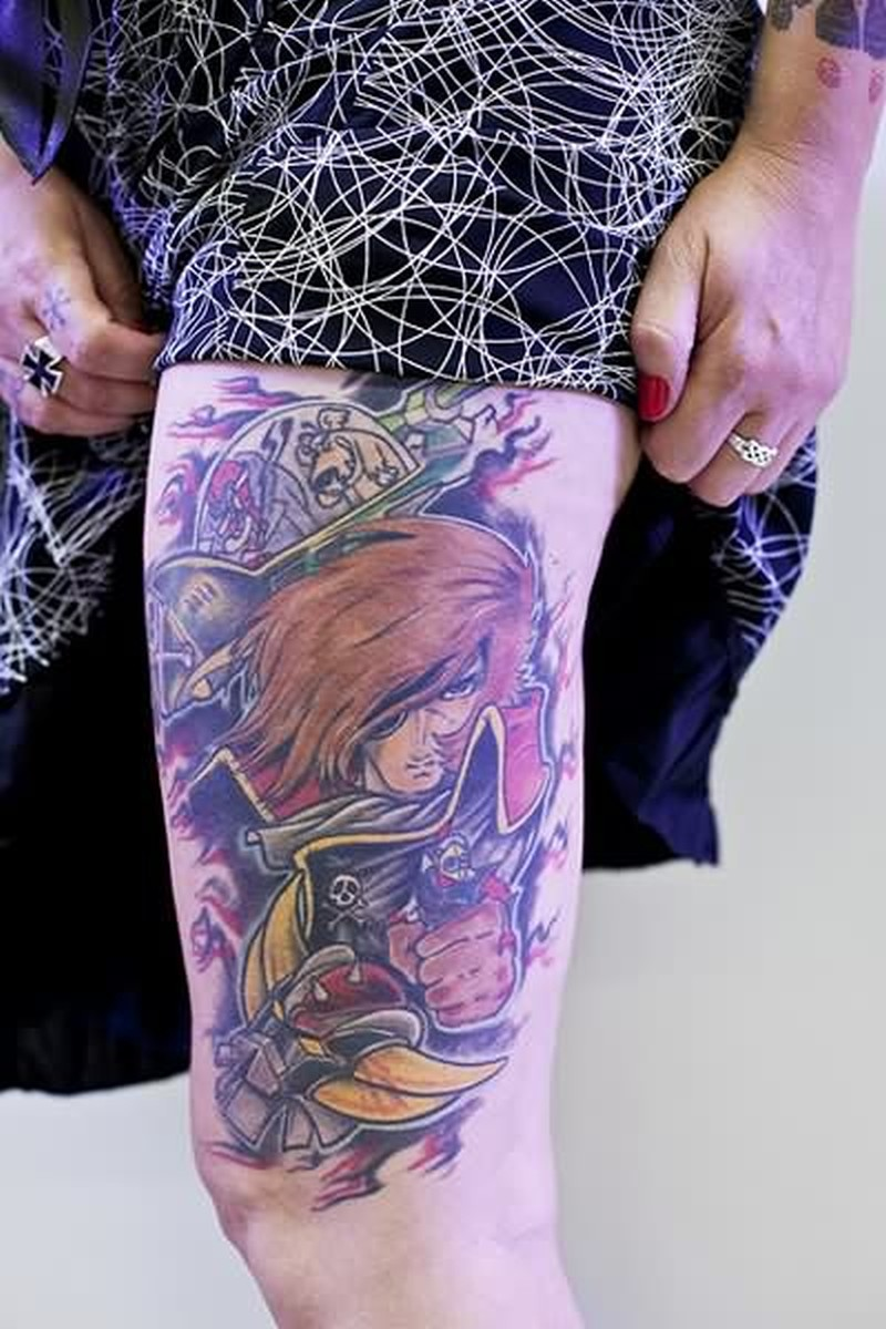 Cartoon tattoo design on thigh for girls
