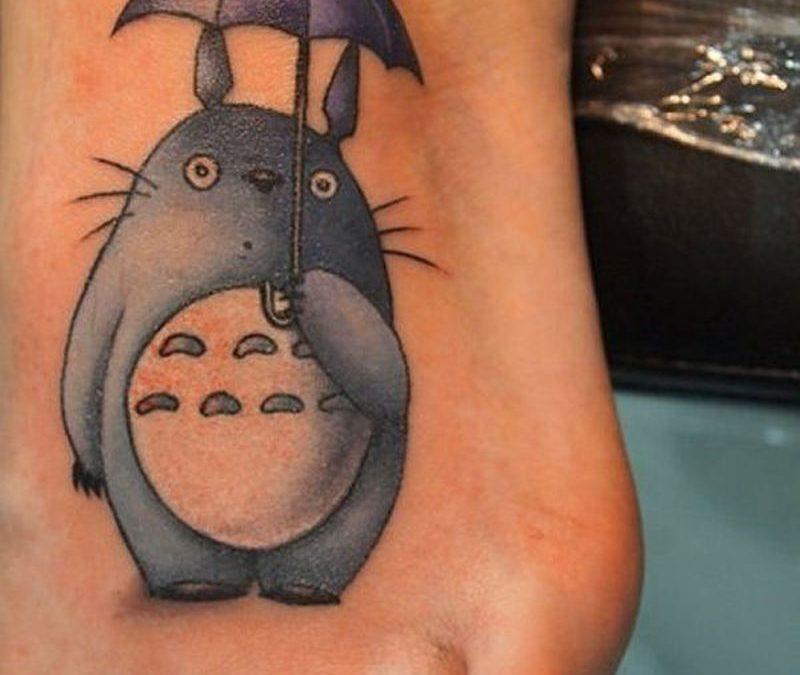 Cartoon totoro tattoo on foot