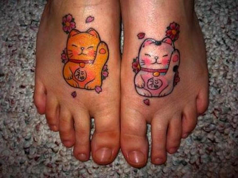 Cat couple on feet tattoo