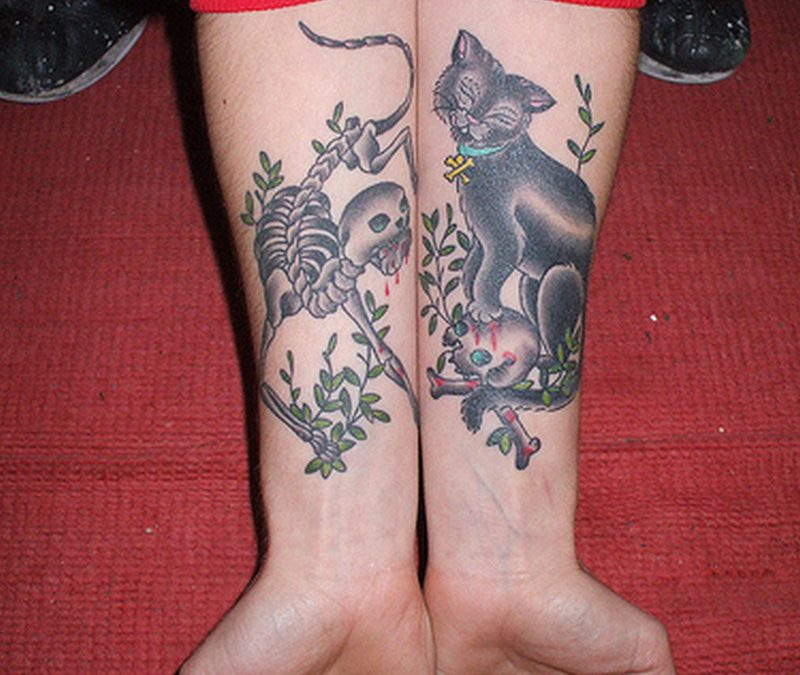 Cat tattoo designs on forearm